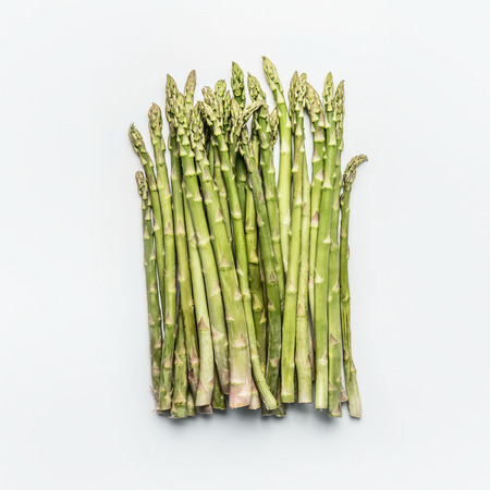 Green asparagus bunch on white background, top view, flat lay. Healthy  seasonal food 写真素材