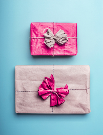 Gift boxes in wrapping paper on pastel blue background, top view