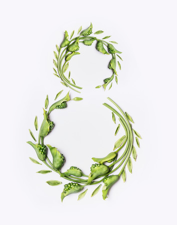 Number 8 made with green flowers and leaves on white background