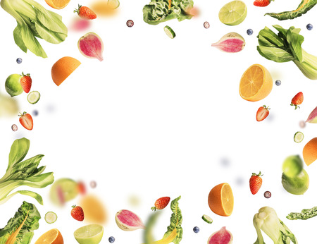Flying fruits and vegetables ingredients on white background .  Healthy food concept