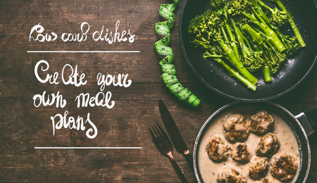 Low carb dishes with meat balls, broccoli, cutlery and measure tape on wooden background with text: create your own meal plans, top view. Healthy weight loss diet food concept