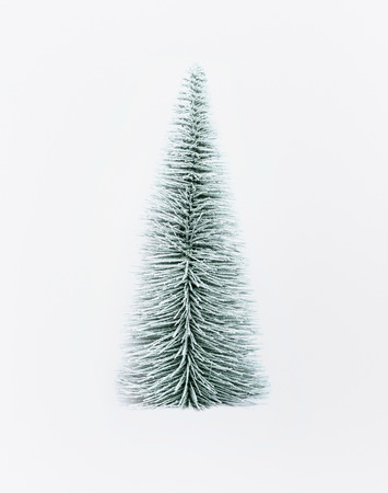 Decorative artificial christmas tree on white background