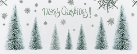 Merry Christmas greeting card with decorative trees and snowflakes on white background, banner Stock Photo