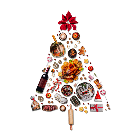 Christmas tree made with various Christmas food: turkey on platter, roasted ham, sweets and candies, cookies , mulled wine, gingerbread  man decorated with gift box and poinsettia. Isolated on white Stock Photo