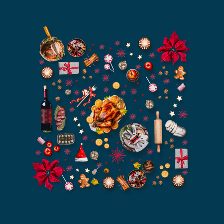 Various Christmas foods and red decoration for Christmas dinner. Composition pattern on dark blue background, top view
