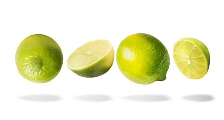 Flying lime with shadow, isolated on white background. Horizontal. Healthy food. Imagens