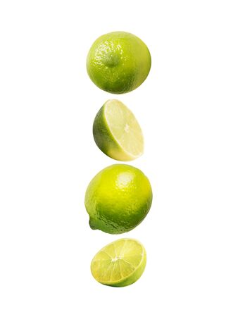 Flying lime, isolated on white background. Healthy food. Vertical Imagens