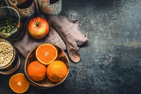 Healthy vegan breakfast ingredients on dark rustic kitchen table, top view. Copy space. Weight loss dieting food