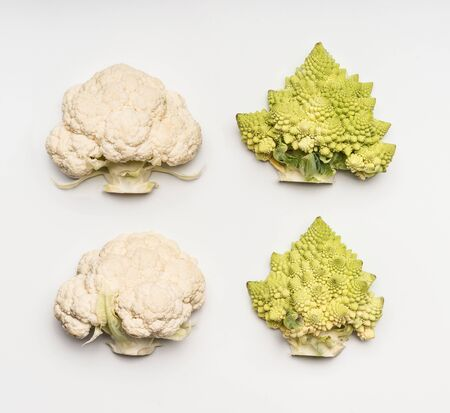 Cauliflower and romanesco kohl on white background, top view. Flat lay