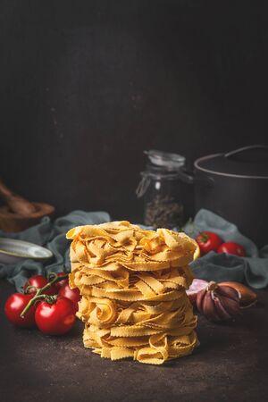 Close up of homemade italian pasta on dark kitchen table. Healthy italian food. Still life Stock Photo