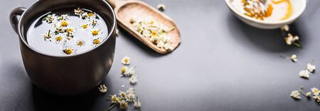 Banner with close up of cup of chamomile tea. Herbal tea concept. Template