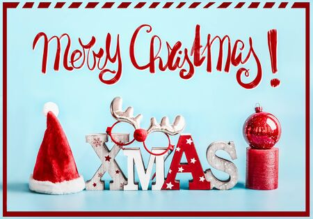 Merry Christmas greeting card with holiday decoration on blue background. Festive Xmas concept.
