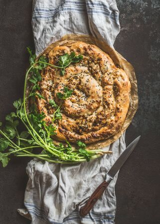 Savory pie with Phyllo dough. Su boregi, burek or borek on dark rustic background. Top view. Turkish cuisine. 写真素材