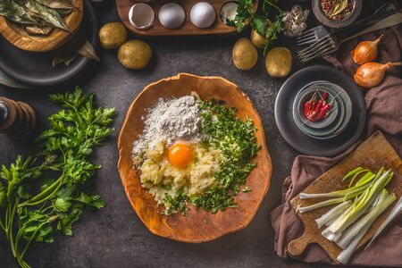 Preparation of potato dough. Mashed potato with egg and flour in wooden bowl on rustic kitchen table background. Top view. Home cuisine Zdjęcie Seryjne