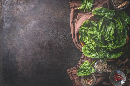 Food background with fresh spinach leaves. Top view. Copy space for your recipes. Dark rustic. Home cuisine. Tasty spinach cooking. Healthy clean food eating Zdjęcie Seryjne
