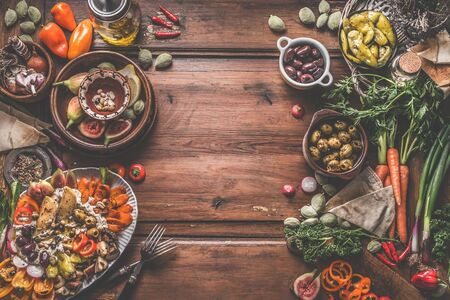 Healthy vegan or vegetarian food background with snacks. Various fresh, pickled and fermented vegetables in bowls. Hummus plate with roasted vegetables and nuts. Olives, figs, green almond , chickpeas Zdjęcie Seryjne