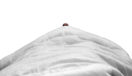 a person s nose is visible under the covers