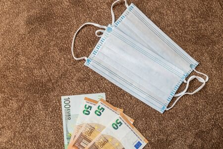 medical masks and money. protection is expensive. Stock Photo