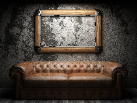 leather sofa and frame in dark room Foto de archivo