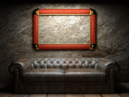 leather sofa and frame in dark room photo