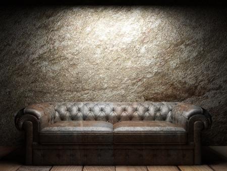 leather sofa in dark room Foto de archivo