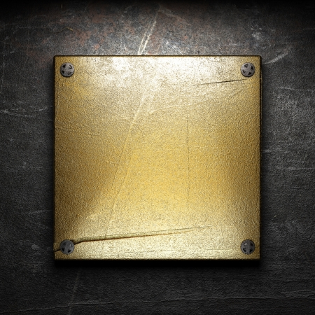 gold plaque: golden plate on wall