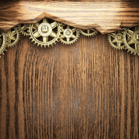 gear wheels on wooden background photo