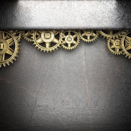 ruote dentate su sfondo di acciaio Archivio Fotografico
