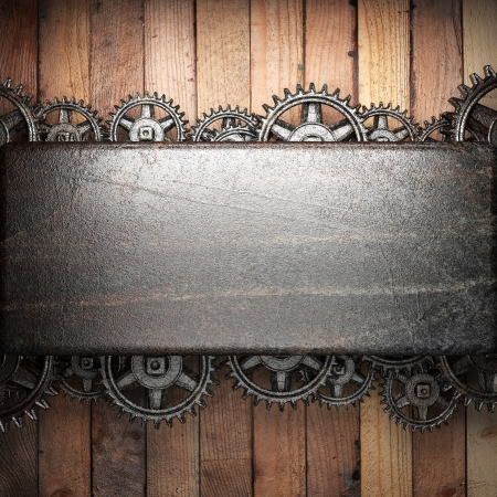 gear wheels on wooden background Stock Photo - 18421788