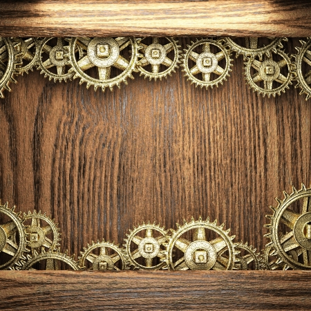 gear wheels on wooden background photo