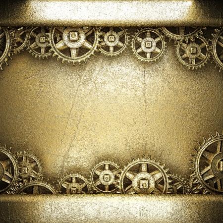 gear wheels on golden background photo