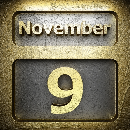 november 9 golden sign on silver photo