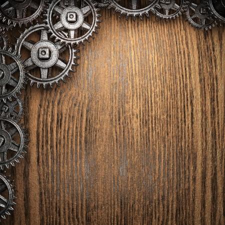 gear wheels on wooden background