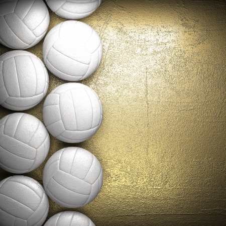 Volleyball ball and golden wall background photo