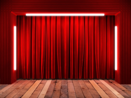 red fabrick curtain on stage photo