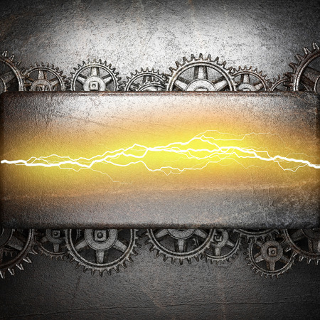 metal background with cogwheel gears and electric lightning photo