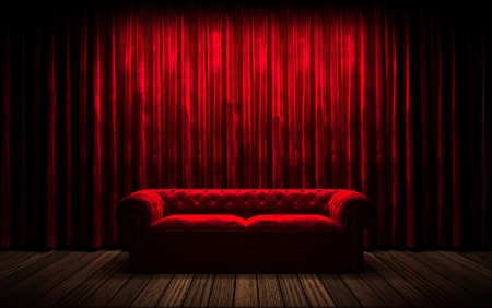 red sofa: red curtain stage with sofa