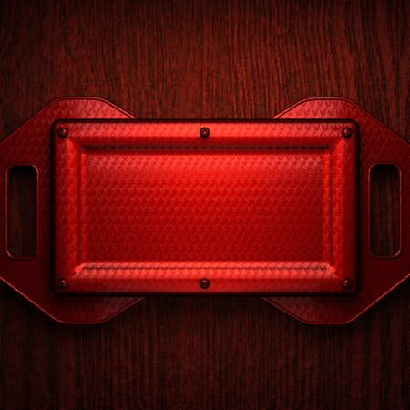 red metal: red polished metal on wooden background Stock Photo