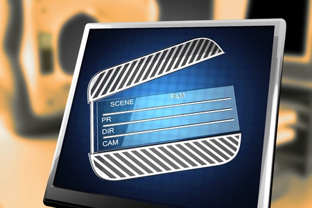 clap: cinema clap on blue background at monitor Stock Photo
