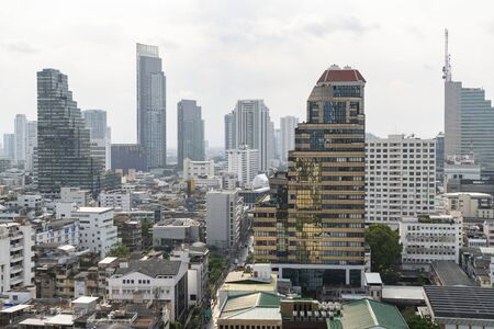 Cityscape of picturesque Bangkok at daytime from rooftop. Panoramic skyline of the biggest city in Thailand. The concept of metropolis. Unique Asia.