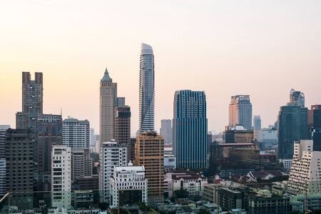 Panoramic view of Bangkok skyline at sunset. Modern city center of capital of Thailand. Contemporary buildings exterior with glass.