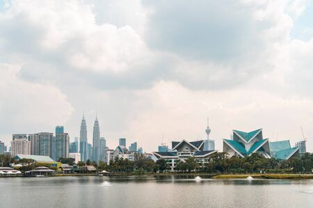 Panoramic view of Kuala Lumpur skyline at day time. City center of capital of Malaysia. Contemporary buildings exterior with glass.