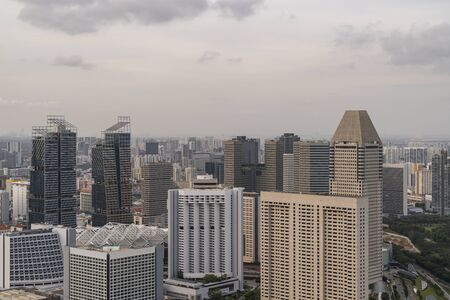 Picturesque panoramic view of Singapore city at sunset. Financial and trading center hub in Asia region. Concept of success. Modern buildings in high-tech world.