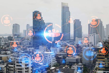 Multi exposure of Bangkok cityscape day time and social network hologram. Concept of media networking. Banque d'images