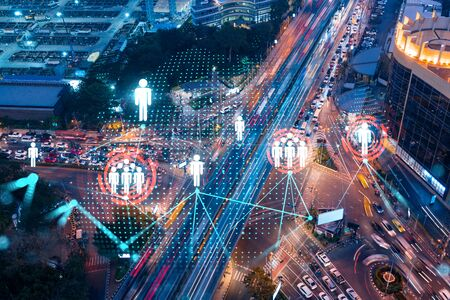 Social media icons hologram on top view of road, busy urban traffic highway at night. Junction network of transportation infrastructure. The concept of networking and success. Double exposure.