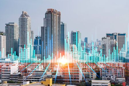 Forex and stock market chart hologram over panorama city view of Bangkok, the financial center in Asia. The concept of international trading. Double exposure. Banco de Imagens