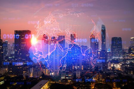 Glowing hologram of Earth planet map on aerial panoramic cityscape of Bangkok at sunset, Asia. The concept of international business. Multi Exposure. Banque d'images