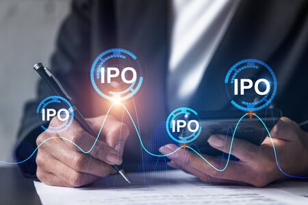 IPO hologram and a woman signing contract use phone. Double exposure. Initial primary offering concept.