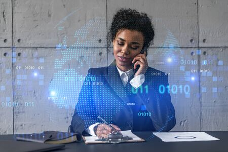 Businesswoman speaks phone and world map hologram. Double exposure.