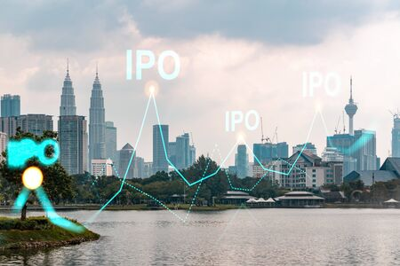 Hologram of IPO glowing icon, sunset panoramic city view of Kuala Lumpur. KL is the financial hub for transnational companies in Malaysia, Asia. The concept of boosting the growth by IPO process. Stock Photo